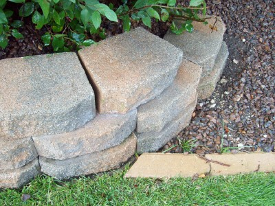 The pressure washer cleaning landscaping bricks for Landscaping bricks